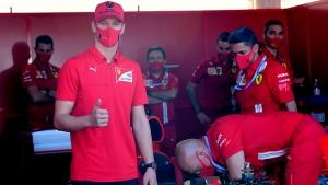 Mick Schumacher, son of former F1 champion Michael Schumacher, visits the Ferrari pit before the Tuscany Formula One Grand Prix the Grand Prix of Tuscany, at the Mugello circuit in Scarperia, Italy, Sunday, Sept. 13, 2020. (Jennifer Lorenzini, Pool via AP)