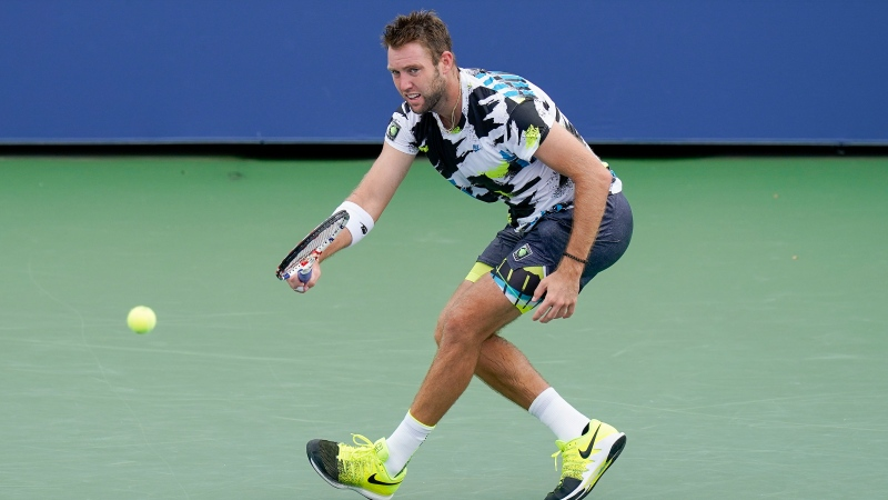 Jack Sock, of the United States, returns a shot to Adrian Mannarino, of France, during the second round of the US Open tennis championships, Wednesday, Sept. 2, 2020, in New York. (AP Photo/Seth Wenig)