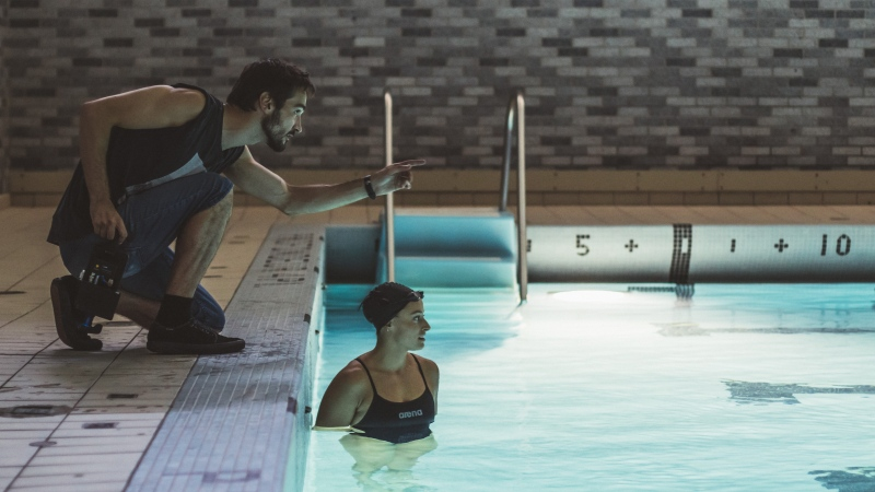 "Director Pascal Plante works with actor/swimmer Katerine Savard for the film ""Nadia, Butterfly"" as shown in this undated handout image. THE CANADIAN PRESS/HO-Annie Tremblay Communications-Maxime Cormier"