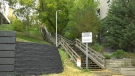 Edmonton police are searching for two people after a man was assaulted and robbed while walking on these stairs in the area of 104 Street and 97 Avenue Tuesday morning. Sept. 29, 2020. (Matt Marshall/CTV News Edmonton)