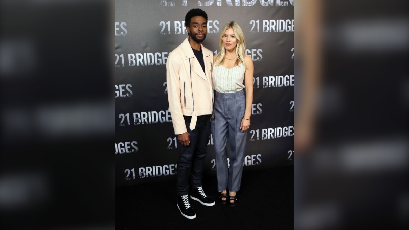 """Chadwick Boseman and Sienna Miller at an event for """"21 Bridges"""" in November of 2019. (David Livingston/FilmMagic/Getty Images via CNN)"""