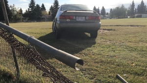 This vehicle crashed into a field shared by Ottewell School and Clara Tyner School on Tuesday, Sept. 29, 2020. (Matt Marshall/CTV News Edmonton)