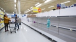 Empty shelves are seen at a Superstore grocery store as some retailers struggle to maintain stock of certain items due to the number of people shopping, amid concerns about the spread of the coronavirus, in Richmond, B.C., on Tuesday, March 17, 2020. (THE CANADIAN PRESS / Darryl Dyck)