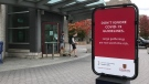 Students walk by a sign at Queen's University in Kingston, Ont., urging everyone to follow COVID-19 guidelines, Sept. 29, 2020. The university has reported 14 cases of COVID-19 since lessons began. (Kimberley Johnson / CTV News Ottawa)