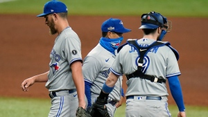 Toronto Blue Jays manager Charlie Montoya, center, takes relief pitcher A.J. Cole, left, out of the game against the Tampa Bay Rays during the seventh inning of Game 1 of a wild card series playoff baseball game Tuesday, Sept. 29, 2020, in St. Petersburg, Fla. Looking on is catcher Danny Jansen. (AP Photo/Chris O'Meara)