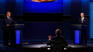 President Donald Trump, left, and Democratic presidential candidate former Vice President Joe Biden, listen to moderator Chris Wallace of Fox News during the first presidential debate Tuesday, Sept. 29, 2020, at Case Western University and Cleveland Clinic, in Cleveland, Ohio. (AP Photo/Patrick Semansky)