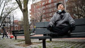 Lobsang Tseten meditates and practices breathing exercises alone to maintain social distancing at a playground, Wednesday, March 25, 2020, in New York. Meditation and mindfulness apps have boomed in the last decade, part of the trend of the year that Apple noted in 2018: self-care apps, particularly those focused on mental health. (AP / John Minchillo)
