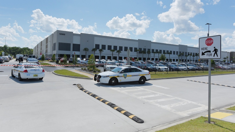 In this Monday, June 29, 2020, file photo, law enforcement respond to a report of a shooting at the Amazon Fulfillment Center on Pecan Park Road near the Jacksonville International Airport in Jacksonville, Fla. (Bob Self/The Florida Times-Union via AP, File)