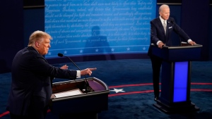 U.S. President Donald Trump makes a points as Democratic presidential candidate former Vice President Joe Biden listens during the first presidential debate Tuesday, Sept. 29, 2020, at Case Western University and Cleveland Clinic, in Cleveland, Ohio. (AP Photo/Morry Gash, Pool)