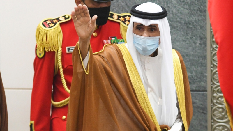 The new Emir of Kuwait Sheikh Nawaf Al Ahmad Al Sabah waves after he performed the constitutional oath at the Kuwaiti National Assembly in Kuwait, on Sept. 30, 2020. (Jaber Abdulkhaleg / AP)