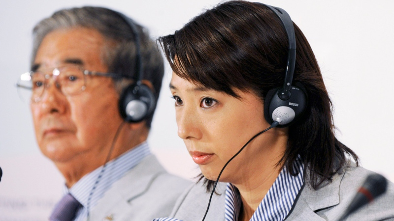 Mikako Kotani, right, during a news conference of Tokyo's bid team in Copenhagen, Denmark, on  Oct. 1, 2009. (Fabian Bimmer / AP)