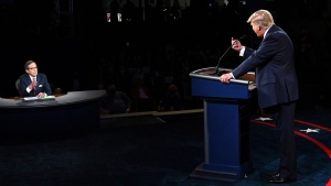 President Donald Trump gestures to moderator Chris Wallace of Fox News during the first presidential debate Tuesday, Sept. 29, 2020, at Case Western University and Cleveland Clinic, in Cleveland. (Olivier Douliery/Pool vi AP)