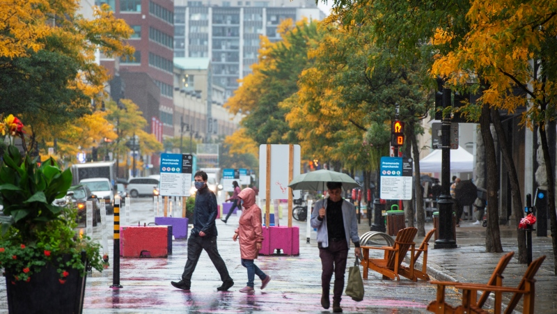 People walk downtown Tuesday, September 29, 2020 in Montreal. The city will be placed on Code Red under Quebec's new colour coded COVID-19 alert system as new cases continue to rise.THE CANADIAN PRESS/Ryan Remiorz