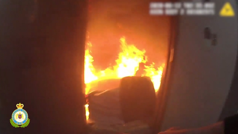Three Australian prison officers are being called heroes after risking their lives to save two inmates trapped in a massive fire.