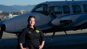 Teara Fraser, commercial pilot and owner of Iskwew Air, poses in front of her plane on the tarmac at Vancouver International Airport in Richmond, B.C., on Sept. 29, 2020. (Jonathan Hayward / THE CANADIAN PRESS)