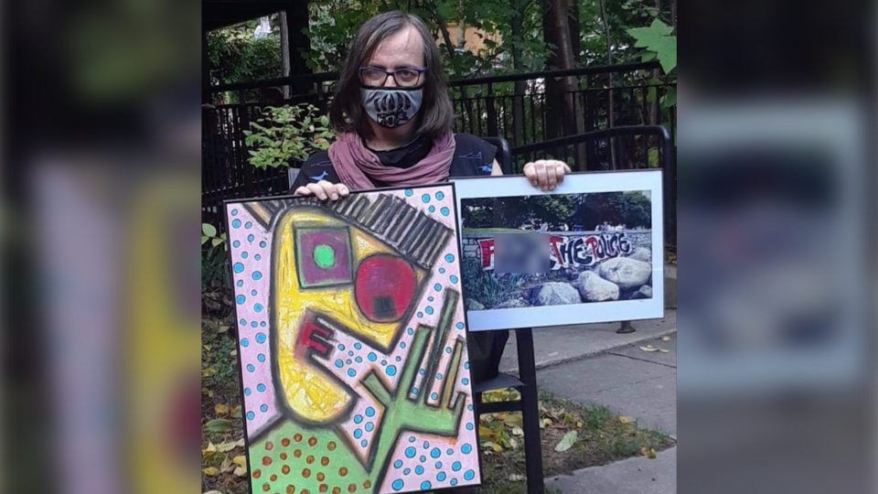 Former B.C. NDP candidate Morgane Oger is seen posing with art that reads