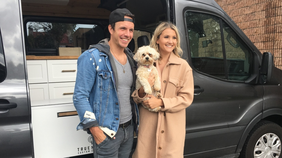 Eric Ethridge and Kalsey Kulyk pose with their van in London, Ont. on Wednesday, Sept. 30, 2020. (Brent Lale / CTV News)