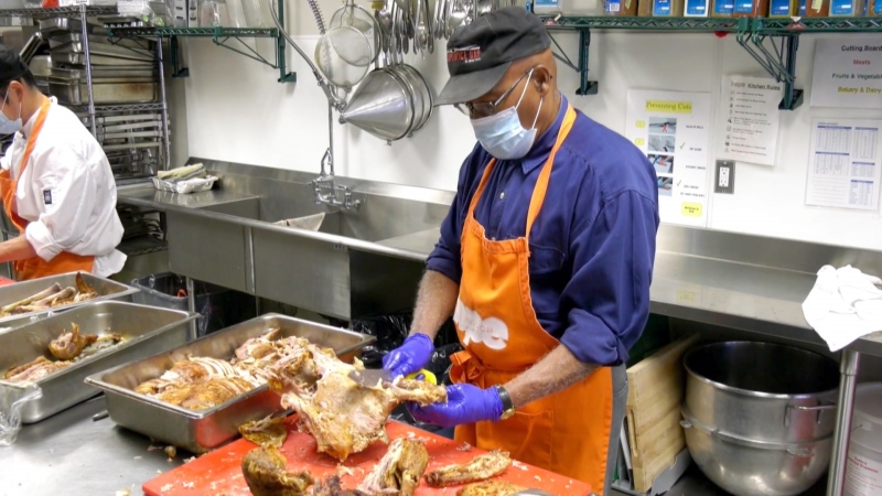 Volunteers with Hope Mission prepare Thanksgiving dinner for Calgarians in need.