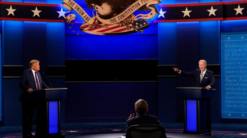 President Donald Trump, left, Democratic presidential candidate former Vice President Joe Biden, right, speaking during the first presidential debate with moderator Chris Wallace of Fox News, center, Tuesday, Sept. 29, 2020, at Case Western University and Cleveland Clinic, in Cleveland, Ohio. (AP Photo/Patrick Semansky)