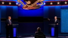 U.S. President Donald Trump, left, Democratic presidential candidate former Vice President Joe Biden, right, speaking during the first presidential debate with moderator Chris Wallace of Fox News, center, Tuesday, Sept. 29, 2020 in Cleveland, Ohio. (AP Photo/Patrick Semansky)