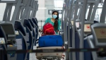 A traveller walks between check-in kiosks at Toronto's Pearson International Airport during the COVID-19 pandemic in Toronto on Tuesday, June 23, 2020. THE CANADIAN PRESS/Nathan Denette
