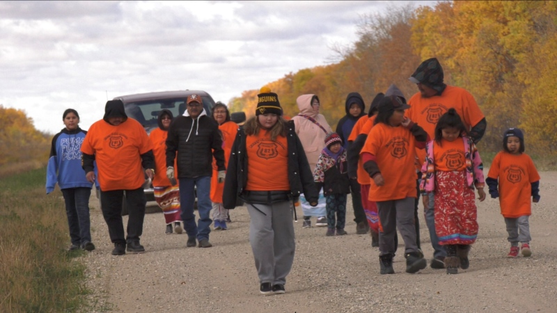 Youth from the Okanese First Nation walked to mark Orange Shirt Day 2020.