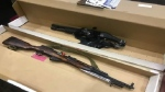 A firearms and ammunition expert testified Wednesday that two guns found in Matthew Raymond's apartment -- a shotgun and a rifle -- were unrestricted and legal to own with a licence.