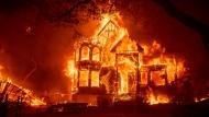 Wildfires in California merge into massive blaze