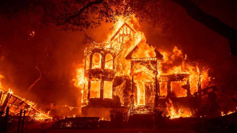 Wildfires in California merge into massive blaze