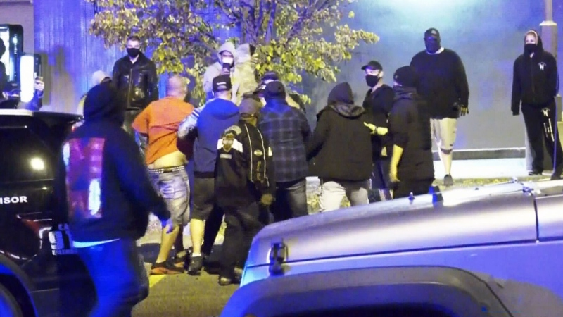 Far-right blamed for violence as groups clash