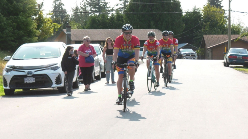 The Tour De Rock team arrives at the Lechinana household on Wednesday to make a special visit to a junior rider who couldn't experience the tour last year because of her cancer treatment.