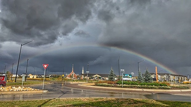 Amidst the weird gloomy and rainy afternoon, this beautiful rainbow appeared. Photo by Karen Dumlao.