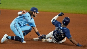 Toronto Blue Jays shortstop Bo Bichette tags out Tampa Bay Rays' Randy Arozarena (56) as he gets caught attempting to steal second base during the sixth inning of Game 2 of an American League wild-card baseball series Wednesday, Sept. 30, 2020, in St. Petersburg, Fla. (AP Photo/Chris O'Meara)