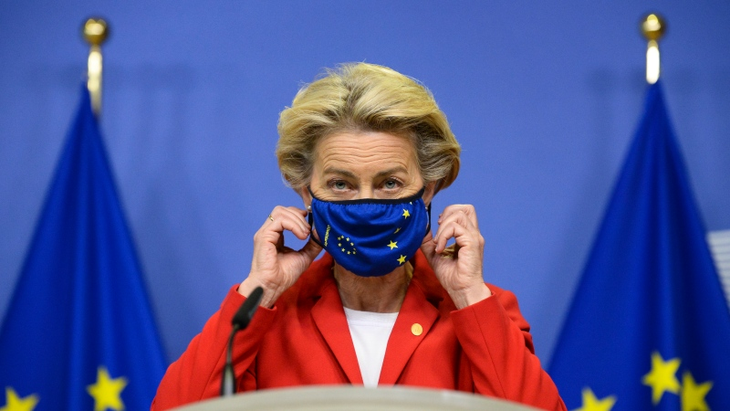 European Commission President Ursula von der Leyen, takes off her protective mask prior to making a statement regarding the Withdrawal Agreement at EU headquarters in Brussels, Thursday, Oct. 1, 2020. (Johanna Geron, Pool via AP)