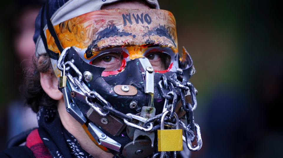 A man takes part in an anti-mask rally in Montreal, on Wednesday, September 30, 2020. THE CANADIAN PRESS/Paul Chiasson