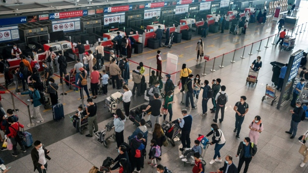 Hundreds of millions of people in China are hustling to take their first major holiday since the emergence of the coronavirus. (AFP)