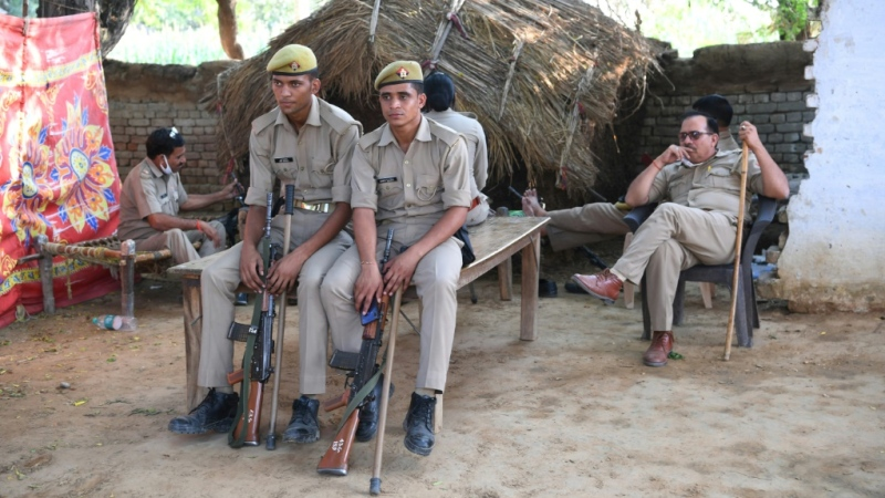 Uttar Pradesh police guard the family house of a 19-year-old woman, who died after being allegedly gang-raped by four men. (AFP)