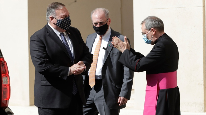 U.S. Secretary of State Mike Pompeo, left, is greeted by Monsignor Joseph Murphy, head of Vatican protocol, on Oct. 1, 2020. (Andrew Medichini / AP)