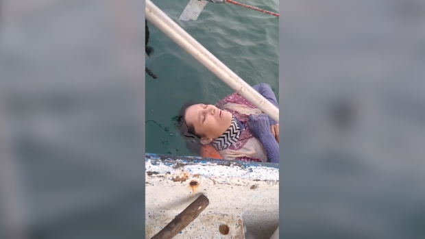 Screenshot taken from a video showing Angélica Gaitán, a woman who was found alive and rescued by fishermen who discovered her floating in the Caribbean Sea off the coast of Colombia on Sept. 26, 2020. Her family had reported her missing and says they hadn't heard from her since 2018. (Credit: Rolando Visbal via Storyful)