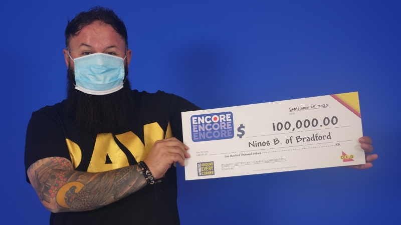 Ninos Barcham, 39, of Bradford, Ont., holds his big cheque at the OLG Prize Centre in Toronto after winning with Encore in the Sept. 17, 2020, Daily Grand draw. (OLG)