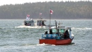 Members of the Potlotek First Nation, head out into St. Peters Bay from the wharf in St. Peter's, N.S. as they participate in a self-regulated commercial lobster fishery on Thursday, Oct. 1, 2020, which is Treaty Day. The day recognizes the signing of peace and friendship treaties between the Mi'kmaq and the Crown in the 1700s. (THE CANADIAN PRESS /Andrew Vaughan)
