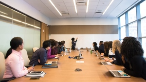 Colleagues are seen at a meeting in an office boardroom in this undated file photo. (Photo by Christina Morillo from Pexels)
