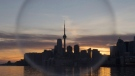 The Toronto skyline is seen through a soap bubble on April 9, 2017. THE CANADIAN PRESS/Frank Gunn