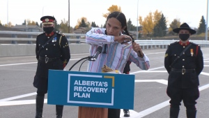 Seth Cardinal Dodginghorse cut off his braids and tossed them on the ring road in an act of protest during the ceremonial opening of Tsuut'ina Trail