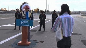 Chief Roy Whitney addresses Seth Cardinal Dodginghorse after Dodginghourse interrupted the ceremonial Tsuut'ina Trail opening to express his pain regarding his family's displacement