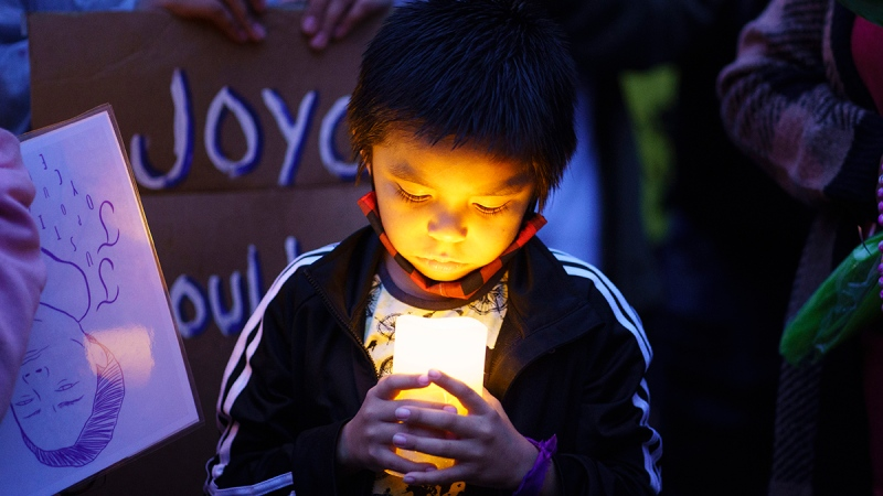 Lucas, one of Joyce Echaquan's children, attends a vigil in front of the hospital where his mother died in Joliette, Que. on Tuesday, September 29, 2020. A nurse has been fired after Echaquan, an Indigenous woman who was dying Monday night in the hospital, was subjected to degrading remarks. THE CANADIAN PRESS/Paul Chiasson