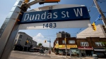 A Dundas Street West sign is pictured in Toronto, Wednesday, June 10, 2020. THE CANADIAN PRESS/Giordano Ciampini