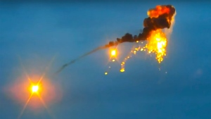 This image taken from video released by the Armenian Defense Ministry on Thursday, Oct. 1, 2020 allegedly shows the shooting down of an Azerbaijani unmanned aerial vehicle by a rocket during fighting between Armenian and Azerbaijani forces at the contact line of the self-proclaimed Republic of Nagorno-Karabakh, Azerbaijan. (Armenian Defense Ministry via AP)
