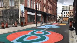 Crews work on art in downtown Kitchener on Oct. 1, 2020 (Dan Lauckner / CTV News Kitchener)