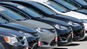 Cars are parked in an auto dealer lot Wednesday, April 15, 2020, in unincorporated St. Louis County, Mo. (AP Photo/Jeff Roberson)